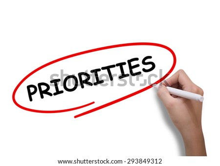 Priorities word drawn by hand on a transparent board - stock photo
