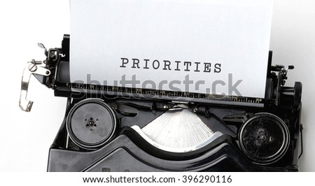 Priorities written on vintage typewriter - stock photo