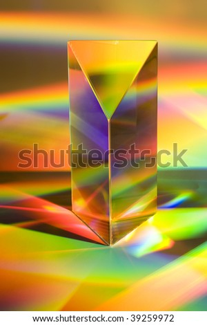 Prism with abstract rainbow efffects.  Vertical format - stock photo