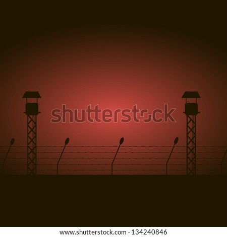 Prison fence with towers - stock photo