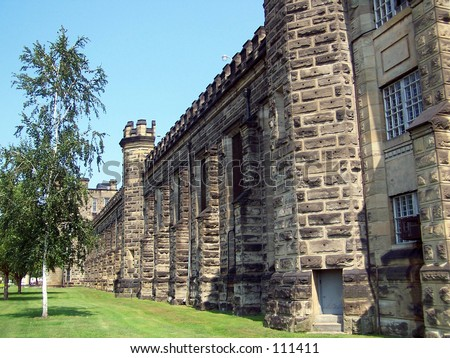 Prison wall.  The West Virginia State Penitentiary that once held Charles Manson (now closed). - stock photo
