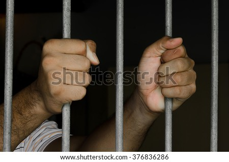Prisoners are in prison with dark environments. - stock photo