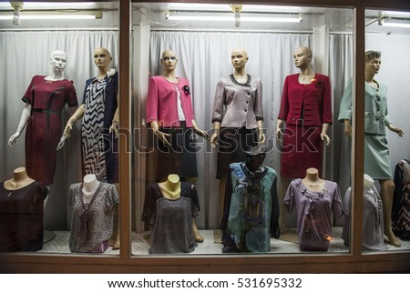 Pristina, Kosovo - August 20, 2014. A boutique window with dressed mannequins at the center of the city of Pristina in Kosovo.
