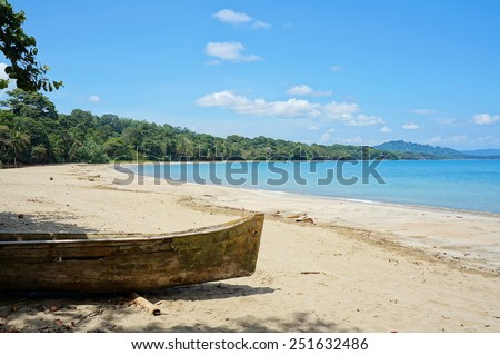 Pristine beach of Punta Uva with an old dugout canoe in foreground, Caribbean coast of Costa Rica, Puerto Viejo de Talamanca - stock photo
