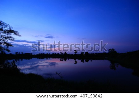 Pristine nature of sunset over the lake - stock photo