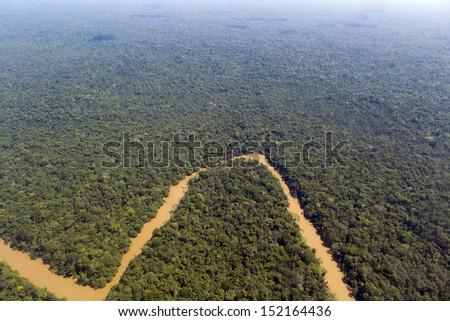Pristine tropical rainforest in the Ecuadorian Amazon. The Rio Cononaco viewed from the air. - stock photo