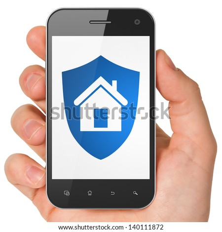 Privacy concept: hand holding smartphone with Shield on display. Generic mobile smart phone in hand on White background.