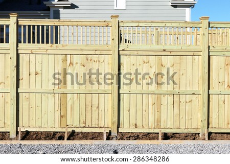 Privacy fence in a new home development. - stock photo