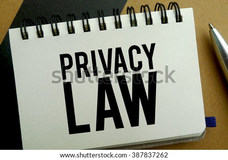 Privacy law memo written on a notebook with pen