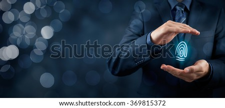 Privacy policy and security concepts. Protect your individuality in business. Businessman with protective gesture and fingerprint in hands. Wide banner composition with bokeh in background. - stock photo