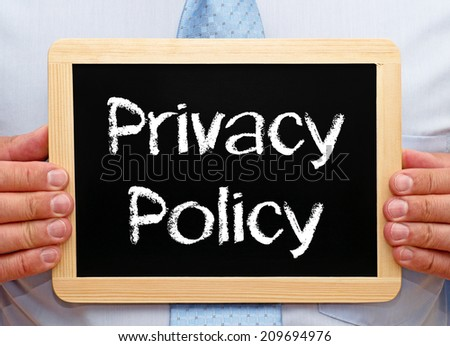Privacy Policy - Businessman with Chalkboard - stock photo