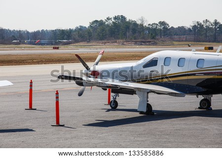Private aircraft on the tarmac of a small regional airport