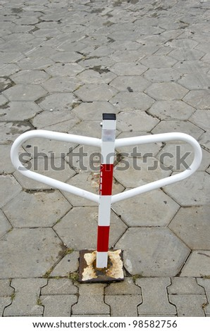 private car parking place marked with folding column. city lack of space for automobiles. - stock photo