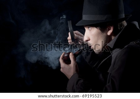 Private detective searching for information, isolated on a black background