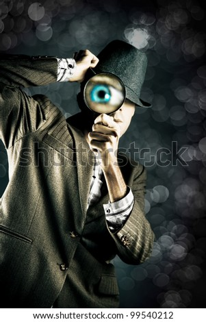 Private Eye Spying And Searching Through A Magnifying Glass At Night During A Stealth Undercover Operation To Reveal And Find The Hidden Truth