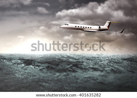 Private jet flying over the ocean. Business trip concept - stock photo