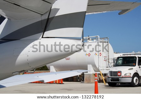 Private jet getting ready for departure - stock photo