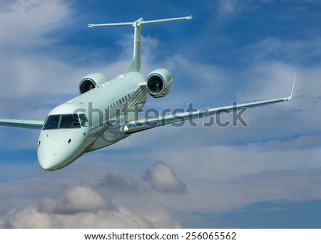 Private jet isolated on blue cloudy sky - stock photo