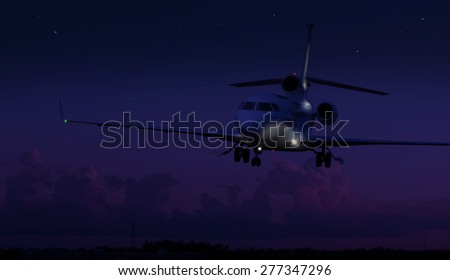 Private jet landing in the middle of the night  - stock photo