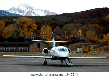private jet on tarmac ready for passenger boarding - stock photo