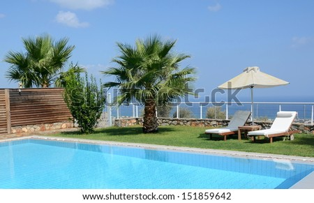 Private oceanside swimming pool - private pool with a view of the Mediterranean - stock photo