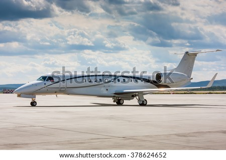 Private plane on the main taxiway - stock photo