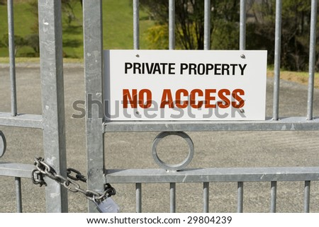 Private Property - No Access Sign on a Padlocked Gate - stock photo