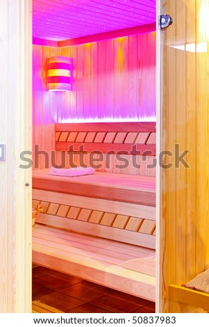 Private steam room with pink ambiance light