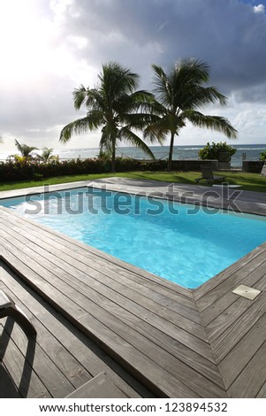 Private swimming pool in tropical area - stock photo
