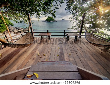 Private terrace with hammocks in tropical. - stock photo