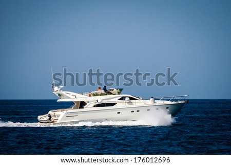Private yacht cruising on the sea - stock photo