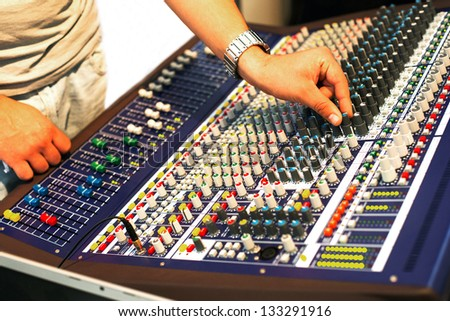 Pro mixing console at a recording studio . A little of DOF. - stock photo