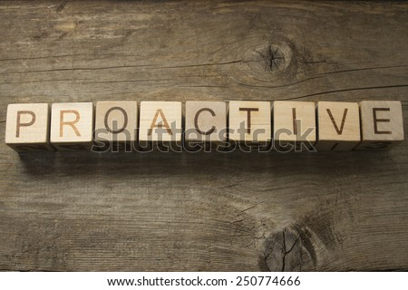 Proactive Concept text on a wooden background - stock photo