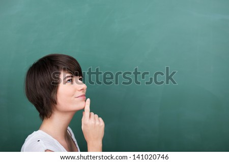 Problem solving young student in class room - stock photo