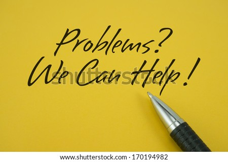 Problems? We Can Help! note with pen on yellow background - stock photo