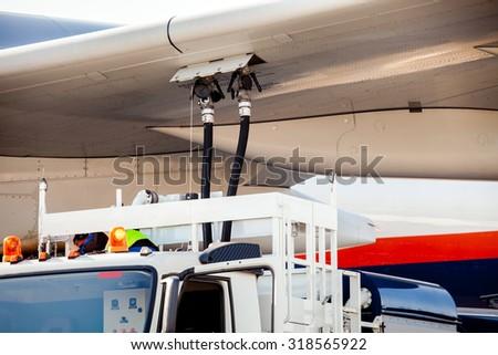 Process of aircraft (airplane) refueling closeup - stock photo