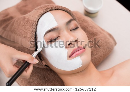 Process of applying face mask - stock photo