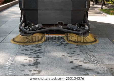 process of cleaning walkways in the Park machine - stock photo