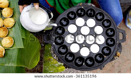 Process of cooking Sweet and Savory Grilled Coconut-Rice Hotcakes, Coconut Rice Cake on banana packaging, Asian dessert, Thai, Thailand, Luang Prabang, Laos - stock photo