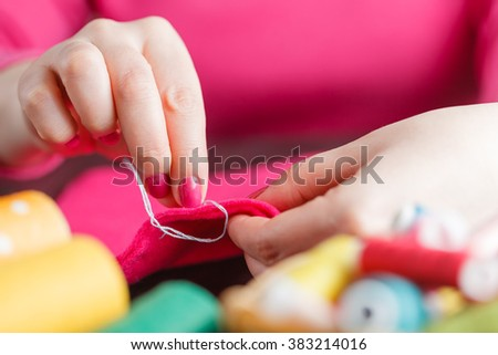 Process of hand made soft toys sewing with felt and needle - stock photo