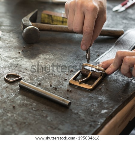 Process of making belt, creating leather bag with a low depth of field - stock photo