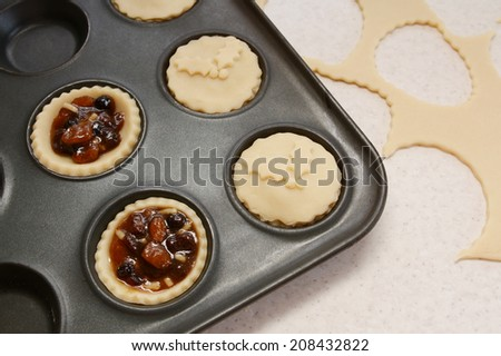 Process of making mince pies with pastry and traditional mincemeat filling - stock photo