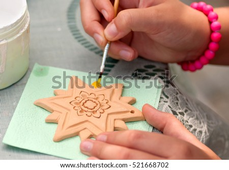 process of painting child of pottery star