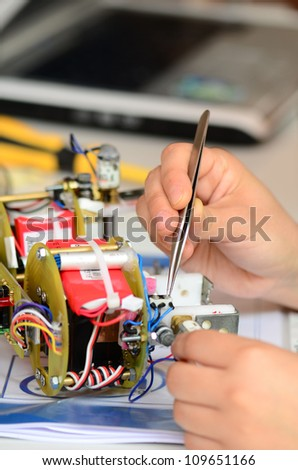 Process of repair of the electronic device close up