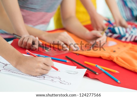 Process of tailoring by designers - stock photo