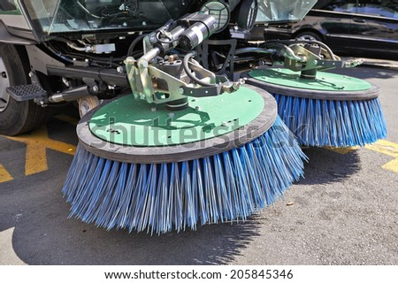 Process of urban street cleaning. Municipal mechanical truck - stock photo