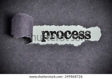 process word under torn black sugar paper  - stock photo