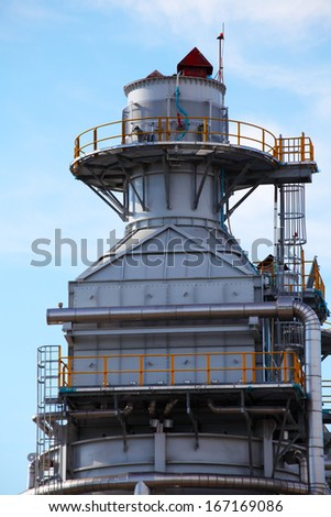 Processing column for offshore platform under construction - stock photo