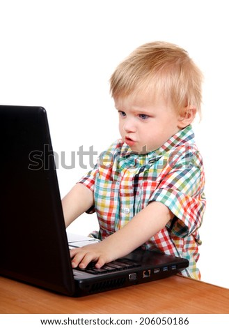 Prodigy Baby Boy playing in Laptop Isolated on the White Background