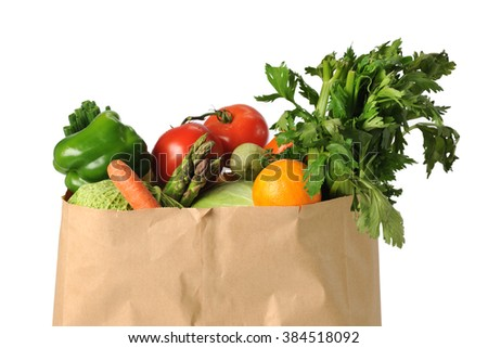 Produce in paper grocery bag isolated over white background - stock photo